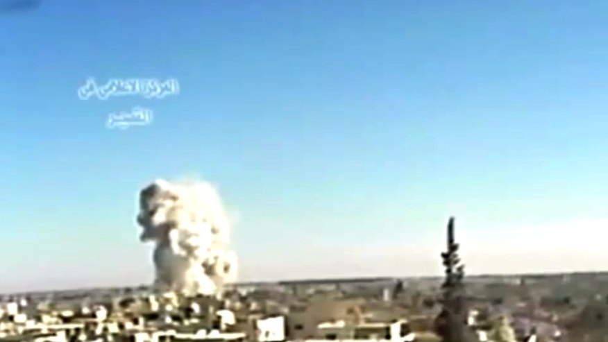 May 29, 2013 - Image from video posted by Ugarit News shows an explosion from shelling in Qusair, Syria.