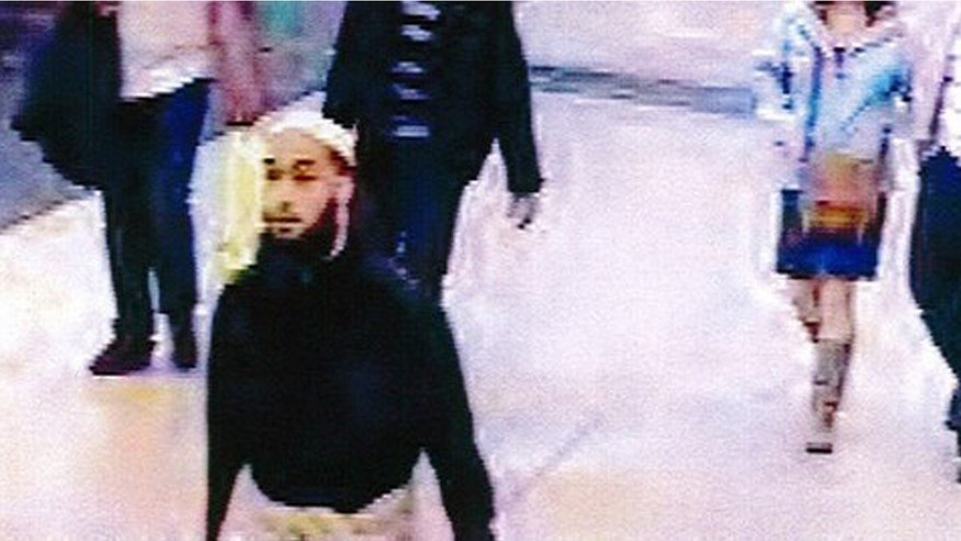 May 25, 2013 - Still image taken from a security camera, provided by French private TV station M6, shows the 22-year-old French suspect, identified only by his first name Alexandre, as he was strolling in a mall before stabbing a French soldier who was patrolling at the La Defense financial and shopping district, north of Paris, France.