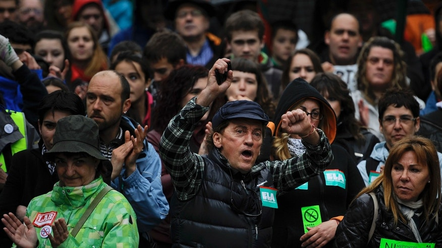 A May 30, 2013 - A demonstrator shouts slogans during the general strike in Pamplona, northern Spain, as people protest against the austerity measures and the strong economic crisis affecting the country with more than six million unemployed.