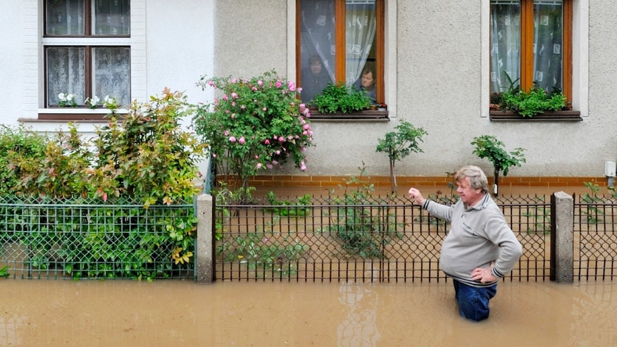 June 3, 2013 - A man stands at his flooded house near Cidlina river in  Novy Bydzov, about 55 miles east of Prague.
