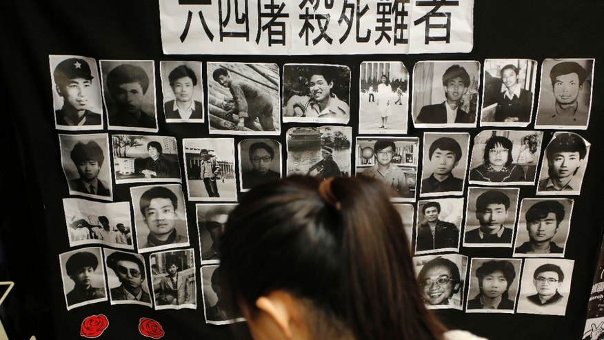 June 3, 2013 - A woman reads a book in front of portraits of victims of the crackdown of the June 4, 1989 pro-democracy movement in Beijing's Tiananmen Square at the June 4 Memorial Museum, run by pro-democracy activists at City University in Hong Kong.