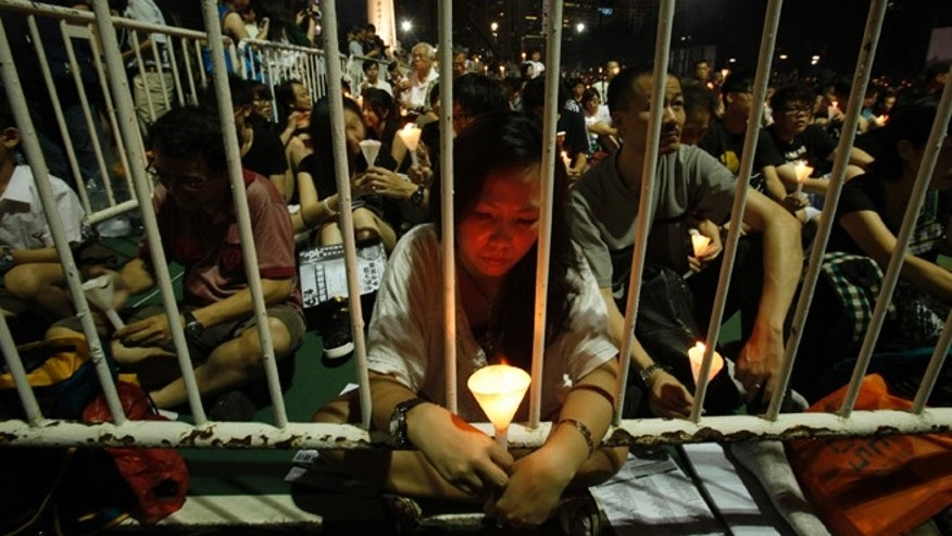 June 4, 2013: Protesters participate in a candlelight vigil at Hong Kong's Victoria Park to mourn those who died in a military crackdown on pro-democracy movement at Beijing's Tiananmen Square in 1989. Tuesday marks the 24th anniversary of the military crackdown of the movement