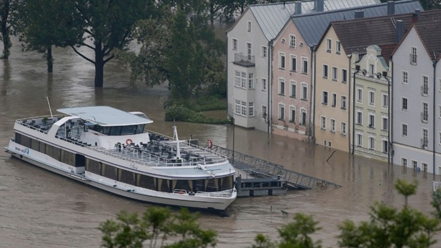 June 4, 2013: A boat waits  in front of the flooded old centre of Passau, southern Germany. Raging waters from three rivers have flooded large parts of the southeast German city following days of heavy rainfall in central Europe.  Floodwaters in Passau are receding from the highest level seen in more than five centuries but cities downstream are bracing themselves as swollen rivers sweep through southeastern Germany.