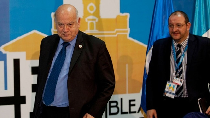 Organization of American States Secretary General Jose Miguel Insulza, left, and Guatemala's Foreign Minister Fernando Carrera arrive for a press conference in Antigua Guatemala, Guatemala, Monday, June 3, 2013.