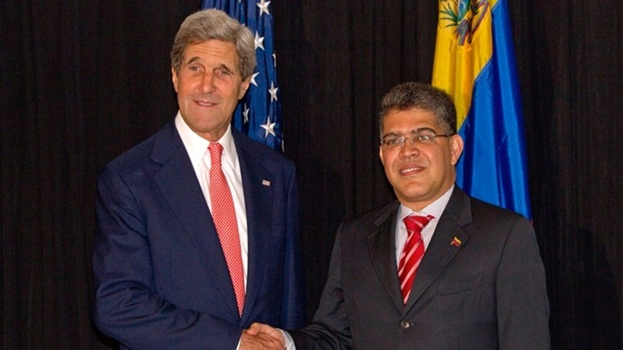 Secretary of State John Kerry and Venezuelan Foreign Minister Elias Jose Jaua during a meeting of AOS General Assembly in Antigua, Guatemala, Wednesday, June 5, 2013.