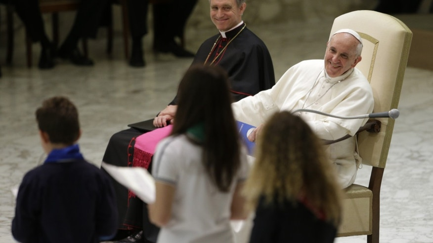 June 8, 2013: Pope Francis smiles he listens to children reading out their message during an audience with students of Jesuit schools and institutions in Italy and Albania, at the Vatican.