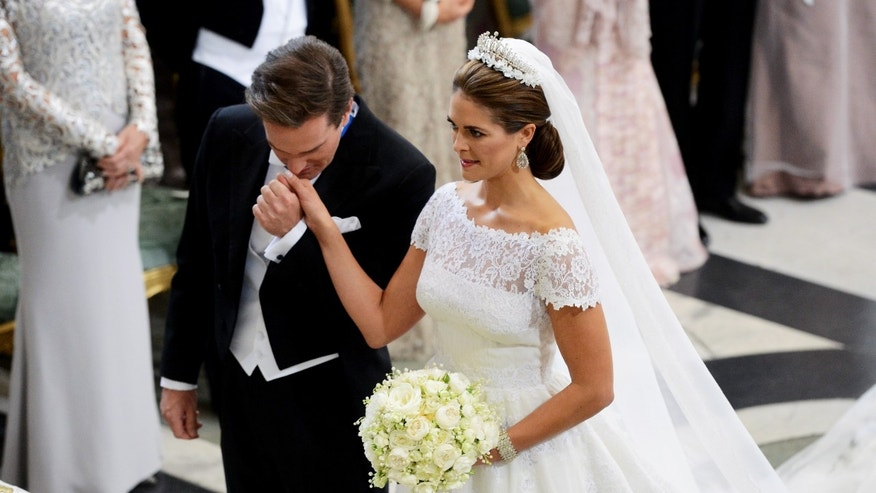Jun 8, 2013: Christopher O'Neill kisses the hand of Princess Madeleine of Sweden at the alter in the Royal Chapel during their wedding ceremony in Stockholm.