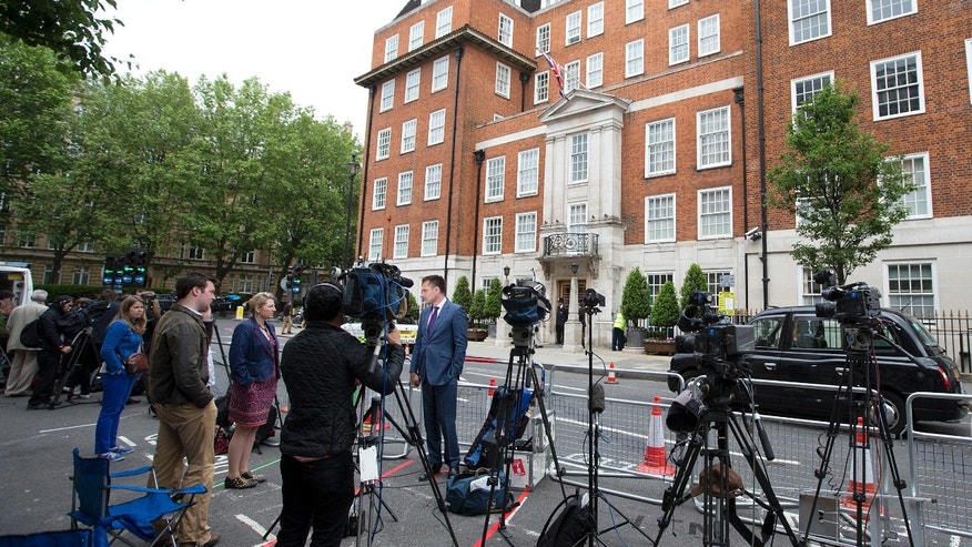 June 7, 2013 - Members of the media stand outside the London Clinic,  where Britain's Prince Philip was to undergo an exploratory operation.