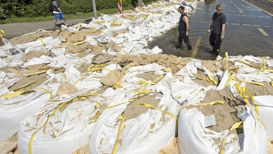 June 10, 2013 - Members of the Federal Agency for Technical Relief,  check wall of sandbags in a flooded area by river Elbe in Magdeburg, central Germany.