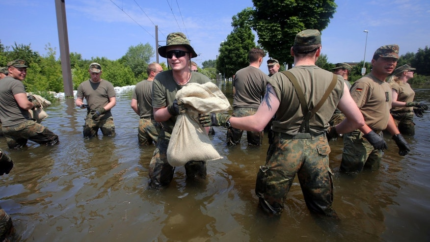 June 9, 2013 - German army soldiers work at a dike in the city of Magdeburg, eastern Germany, Sunday. Thousands of people have been evacuated from their homes in a region of eastern Germany where the Elbe river has flooded and burst through a dam, officials said.