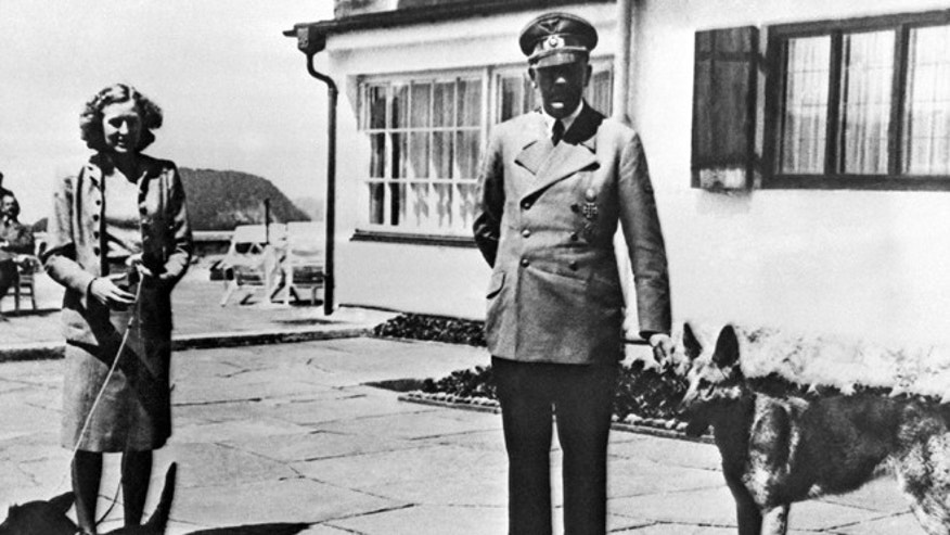 Undated photo of Adolf Hitler and his mistress Eva Braun posing on the Terrace of the Berghof, Berchtesgeden, Germany.
