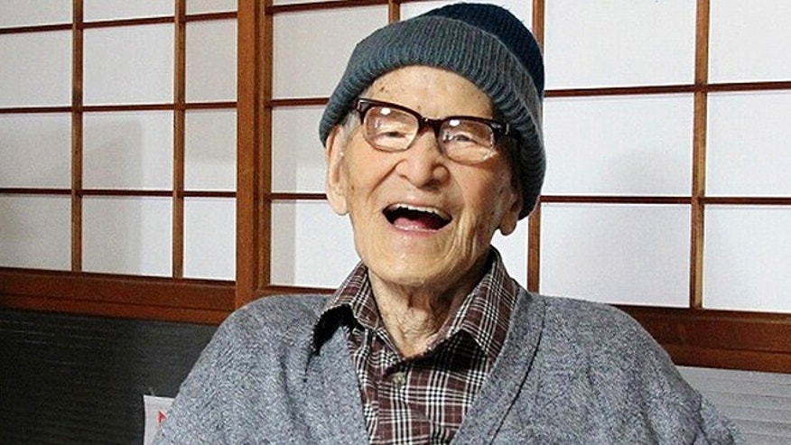 Oct. 15, 2012: Jiroemon Kimura smiles after he was presented with the certificate of the world's oldest living man from Guinness World Records Editor-in-Chief Craig Glenday at his home in the city, Kyoto Prefecture, Japan. (AP)