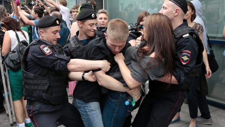 June 11, 2013: Police officers detain gay rights activists as they gathered near the State Duma, Russia's lower parliament chamber, in Moscow, Russia.