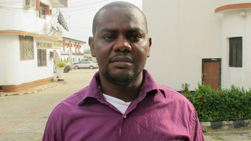 June 12, 2013: Harrison Okene, 29, poses for a photograph after an interview with Reuters outside an hotel in Nigeria.
