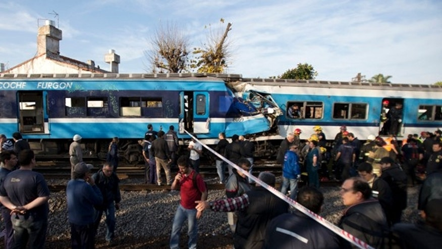 June 13, 2013: Firefighters and rescue workers respond to a fatal commuter train wreck on the outskirts of Buenos Aires, Argentina. A two-level train slammed into another that had stopped between stations during the morning commute Thursday. Firefighters and police are pulling passengers from the wreckage.