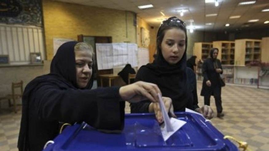 Although these two women are casting their votes for president in Tehran, thousands of Iranians around the world, including in the U.S., will also fill out ballots. (AP)
