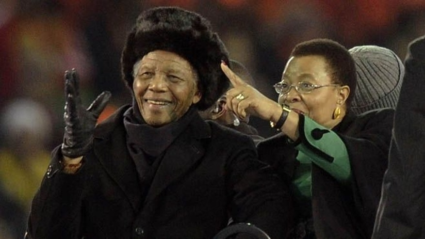 July 11, 2010: In this photo, former South African President Nelson Mandela, left, with his wife Graca Machel, right, attends the final of the FIFA World Cup Soccer Tournament in Johannesburg, Mandela's last public appearance. Mandela, now old and frail, lives in seclusion in his Johannesburg home.