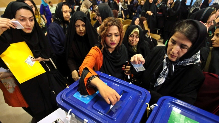 June 14, 2013 - Iranian women cast their ballots for the presidential election, in a polling station  in Tehran, Iran.