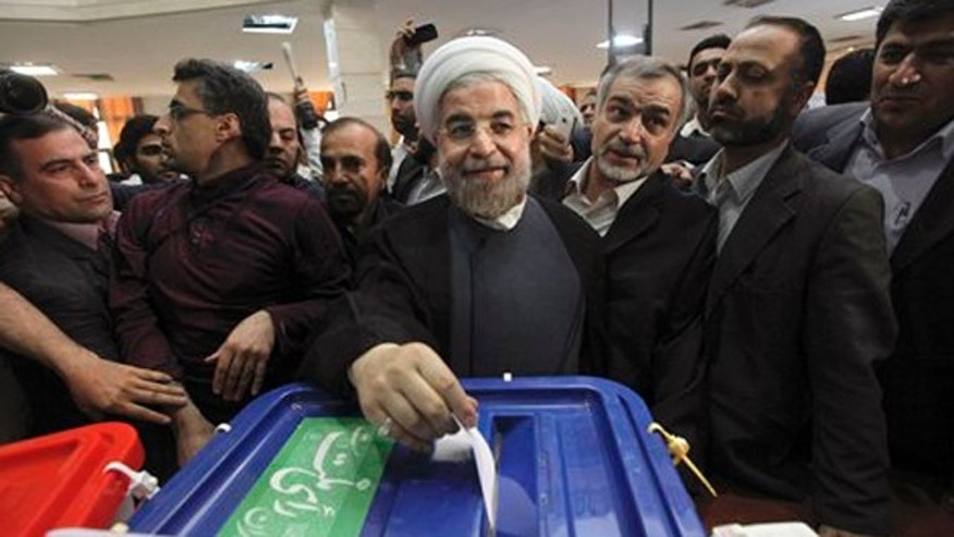 June 14, 2013: Iranian presidential candidate Hasan Rowhani, the country's former top nuclear negotiator, casts his ballot in the presidential election at a polling station in downtown Tehran, Iran.