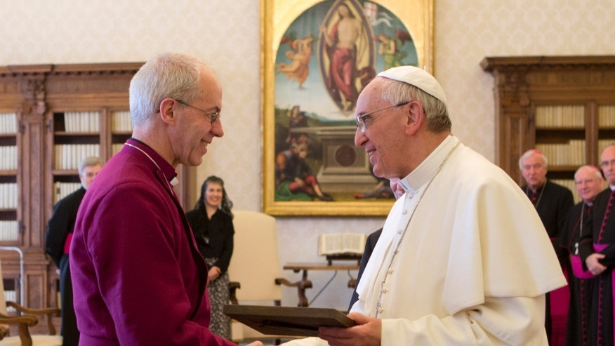 June 14, 2013 - Pope Francis exchanges gifts with the Archbishop  of Canterbury Justin Welby during a private audience at the Vatican.