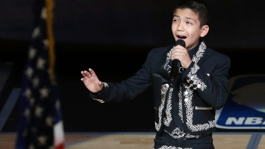 Sebastien De la Cruz sings the national anthem before Game 4 of the NBA Finals basketball series between the San Antonio Spurs and the Miami Heat, Thursday, June 13, 2013, in San Antonio. (AP Photo/David J. Phillip)