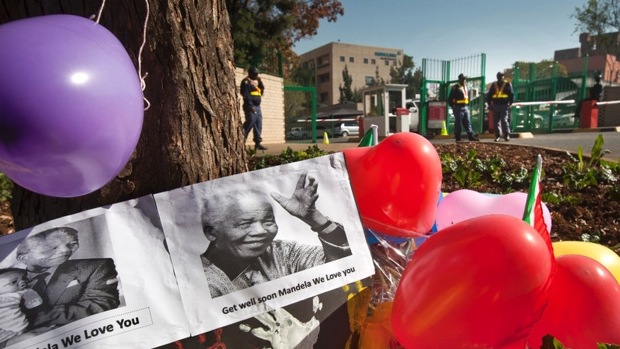June 14, 2013 - Balloons, hand-prints and get well messages left by children lie outside the entrance to the Mediclinic Heart Hospital where former South African President Nelson Mandela is being treated in Pretoria, South Africa.