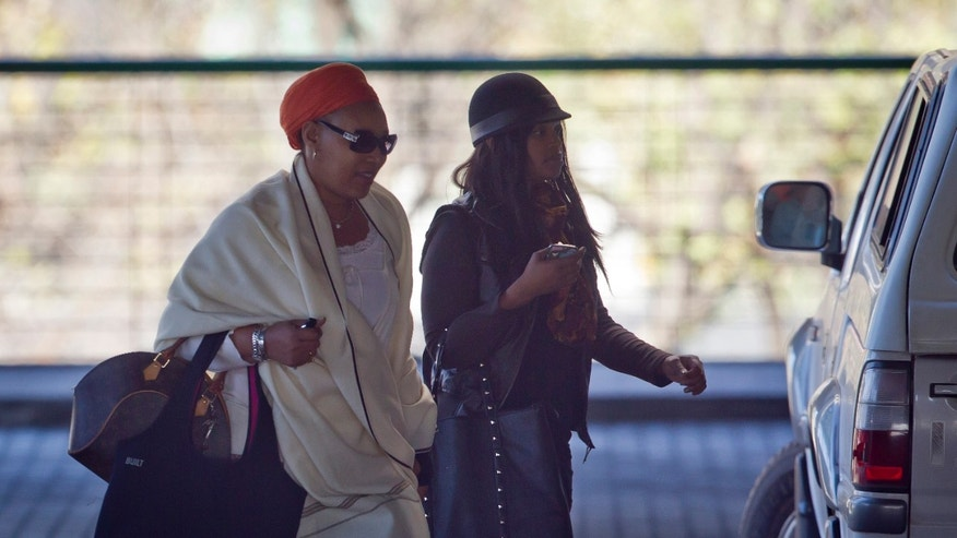 June 14, 2013: Daughter Zenani Dlamini-Mandela and granddaughter Zoleka, right, arrive at the Mediclinic Heart Hospital where former South African President Nelson Mandela is being treated in Pretoria, South Africa.