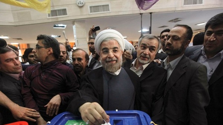 Iranian President Hasan Rowhani ran as a moderate, and the release of 11 political prisoners could be evidence of a shift in Iran. (AP)