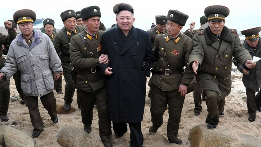 March 7, 2013: In this file photo released by the Korean Central News Agency (KCNA) and distributed by the Korea News Service, North Korean leader Kim Jong Un, center, walks with military personnel as he arrives for a military unit on Mu Islet, located in the southernmost part of the southwestern sector of North Korea's border with South Korea.