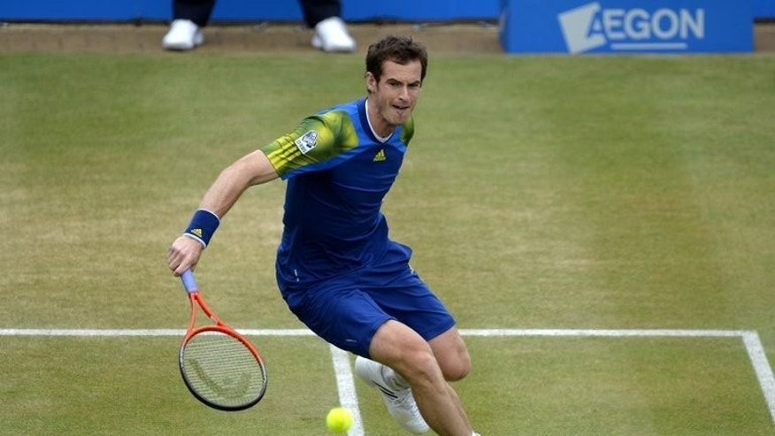 Andy Murray returns to Croatia's Marin Cilic during their ATP Aegon Championships final match at the Queen's Club in west London, on June 16, 2013. World number two Murray goes into Wimbledon confident of ending Britain's 77-year wait to crown a home men's champion.