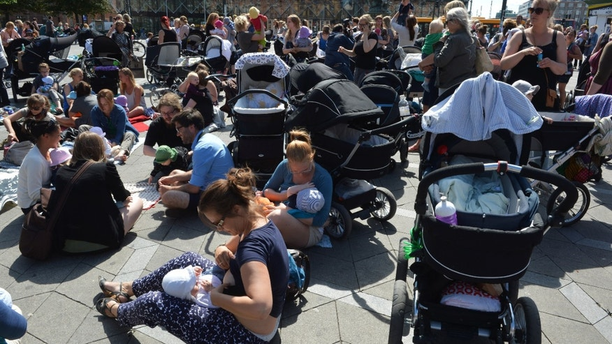 June 17, 2013 - Hundreds of women feed their babies outside City Hall Square in Copenhagen in a demonstration to promote public breastfeeding after customers at a cafe told a woman suckling her baby that it was disgusting.