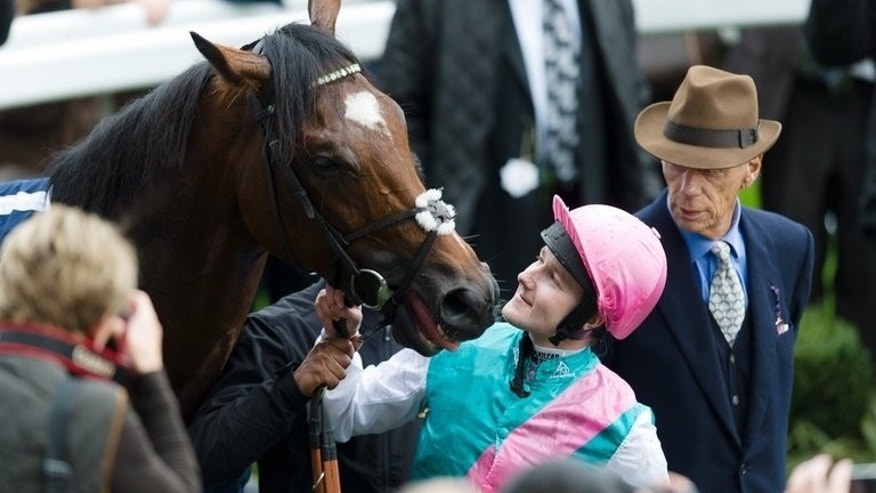 In this file photo, jockey Tom Queally (C) is pictured next to race horse Frankel as trainer Henry Cecil looks on, following the Champion Stakes (Class 1), British Champions Middle Distance race at Ascot, England, on October 20, 2012. Cecil died last Tuesday after a long and courageous battle with cancer aged 70.