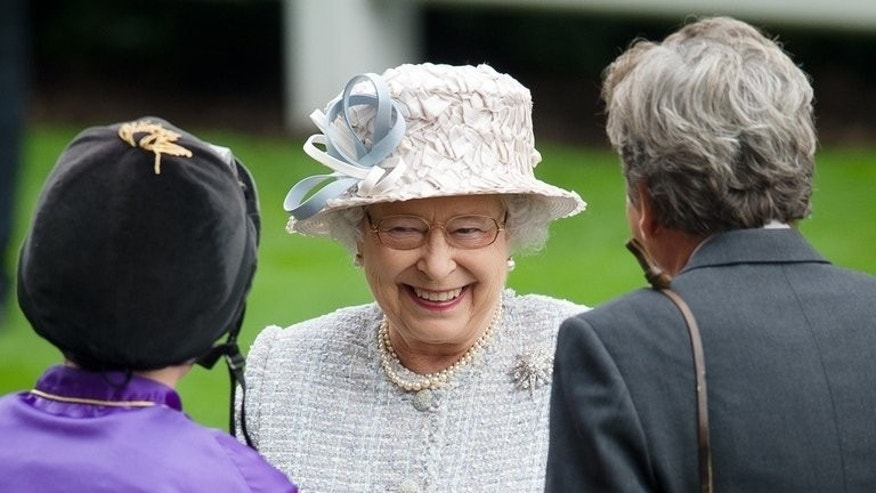 Britain's Queen Elizabeth II shares a joke with jockey Ryan Moore (L), at Ascot, England, on October 20, 2012. Frankel produced perhaps his finest performance to retain his unbeaten record with his 14th victory in the Group One Champion Stakes in what was his final race.