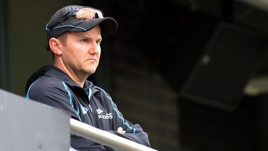 New Zealand coach Mike Hesson looks from the balcony during a rain delay at Edgbaston in Birmingham, central England on June 12, 2013. Hesson was left ruing his side's failure to take their chances after the Black Caps' exit from the Champions Trophy was confirmed on Monday.