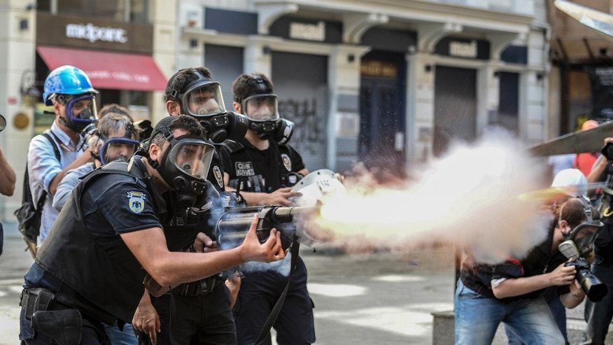 June 16, 2013 - Police fire tear gas as riot police spray water cannon at demonstrators who remained defiant after authorities evicted activists from an Istanbul park.