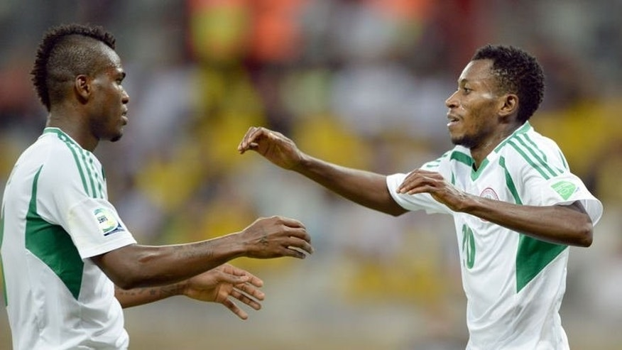 Nigeria's forward Nnamdi Oduamadi (R) celebrates with teammate Brown Ideye after scoring against Tahiti during their FIFA Confederations Cup Brazil 2013 Group B football match, at the Mineirao Stadium in Belo Horizonte on June 17, 2013. Nigeria won 6-1.