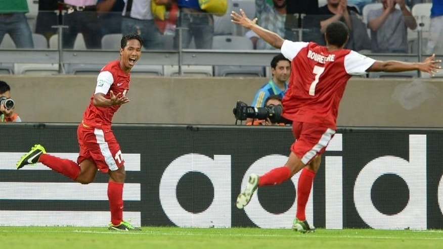 Tahiti's midfielder Jonathan Tehau (L) celebrates after scoring against Nigeria during the FIFA Confederations Cup Brazil 2013 Group B football match, at the Mineirao Stadium in Belo Horizonte on June 17, 2013. Nigeria won 6-1.