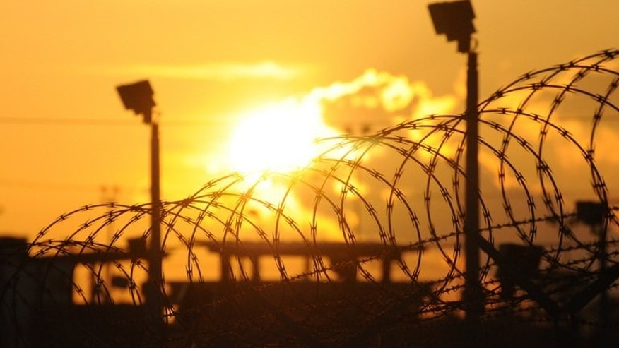 "Sun rises over the US detention center Camp Delta, at the US Naval Base in Guantanamo Bay, Cuba, on October 18, 2012, in this photo reviewed by the US Department of Defense. The Pentagon has released the names of Guantanamo Bay's 46 ""indefinite detainees,"" terror suspects considered too dangerous to transfer from the prison and who cannot be tried in court."