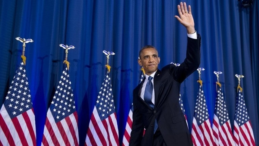 US President Barack Obama waves after speaking about his administration's drone and counterterrorism policies, as well as the military prison at Guantanamo Bay, at the National Defense University in Washington, DC, on May 23, 2013.