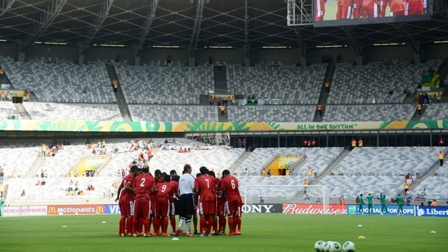 The Tahiti players have a team talk on the pitch before their Confederations Cup clash with Nigeria on June 17, 2013. Ranked 138th in the world, Tahiti are making their first appearance in a competition of this level.
