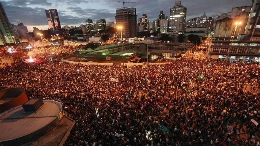 People take part in a protest in Sao Paulo, Brazil on June 17, 2013. Tens of thousands of people took to the streets of major Brazilian cities Monday protesting the billions of dollars spent on the Confederations Cup and higher public transport costs, police said.