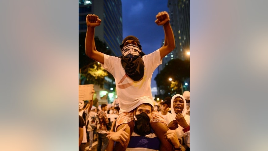 Demonstrators march in downtown Rio de Janeiro on June 17, 2013.