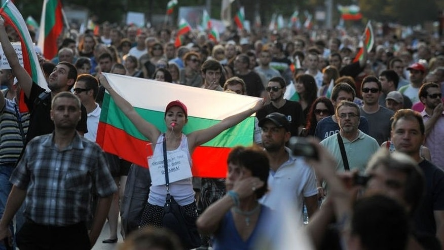 Protesters shout anti-government slogans on June 17, 2013 during a protest in front of the parliament in the center of Sofia. Thousands of Bulgarians took to the streets on Monday in a fourth day of protests demanding the resignation of new Prime Minister Plamen Oresharski after a political blunder sparked public outrage.