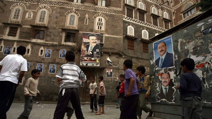 Children play on a street in Sanaa's old city on June 30, 2011. A major problem in Yemen, ravaged by years of factional strife and widespread poverty, is that there is no clear definition of what constitutes a child, making it difficult to battle child marriages or prevent juvenile offenders from being tried as adults.