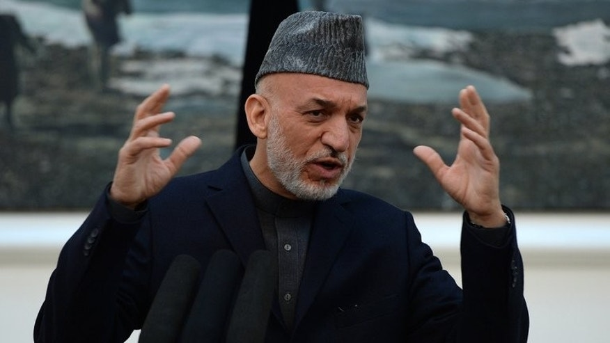 Afghanistan President Hamid Karzai addresses media representatives in Kabul on May 4, 2013. Karzai said that Afghan government envoys are to travel to Qatar to try to open peace talks with the Taliban on a possible deal ending 12 years of conflict.