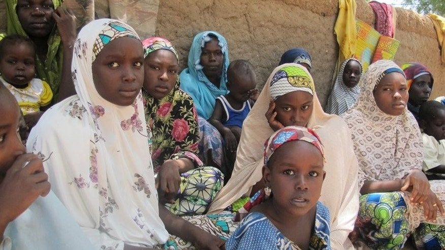 Nigerian refugee women and children in Gance in northern Cameroon on May 25. At least 9,000 people have fled violence in northern Nigeria and crossed into neighbouring countries as a government offensive aims to end a four-year Islamist insurgency, the UN said on Tuesday.