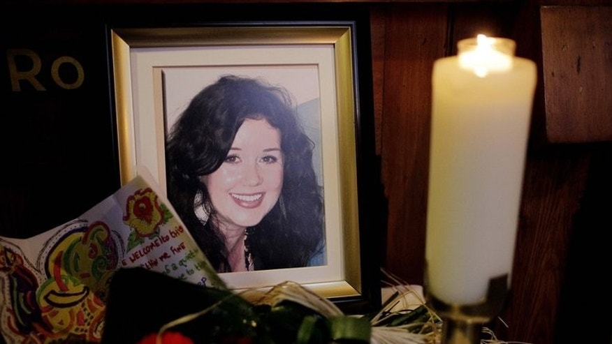 "A candle burns next to portrait of Jill Meagher during a memorial mass at St.Peters Catholic church in Drogheda, Ireland, on October 5, 2012. A serial sex offender was on Wednesday sentenced to life for the ""savage"" rape and murder of Meagher (an Irish) in a Melbourne street, a random killing which shocked Australia and led to an outpouring of emotion."