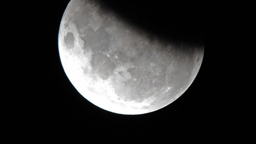 The moon is 37 per cent obscured by the Earth's shadow during the partial lunar eclipse above Sydney on June 4, 2012. Australian scientists Tuesday said they had identified a possible 280 additional craters on the Moon, a finding they said could shed light on the history of the Earth's natural satellite.