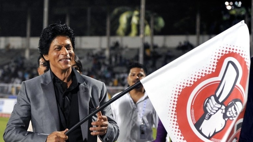 Indian Bollywood film actor Shah Rukh Khan waves a flag at the grand opening ceremony of the Toyota University Cricket Championship in Mumbai on February 23, 2013. Indian officials said Tuesday they were probing reports Bollywood superstar Shah Rukh Khan knows he and his wife are expecting a baby boy, in a country where prenatal sex tests are banned.
