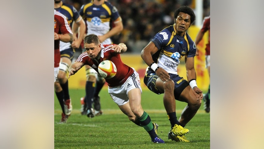 Shane Williams (left) of the British and Irish Lions gets away from Henry Speight during the tour match in Canberra on June 18, 2013. The British and Irish Lions crashed to their first loss on tour in Australia when they were upset 14-12 by the tenacious ACT Brumbies just days out from the opening Test against the Wallabies.